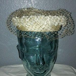 Vintage cream fascionator hat